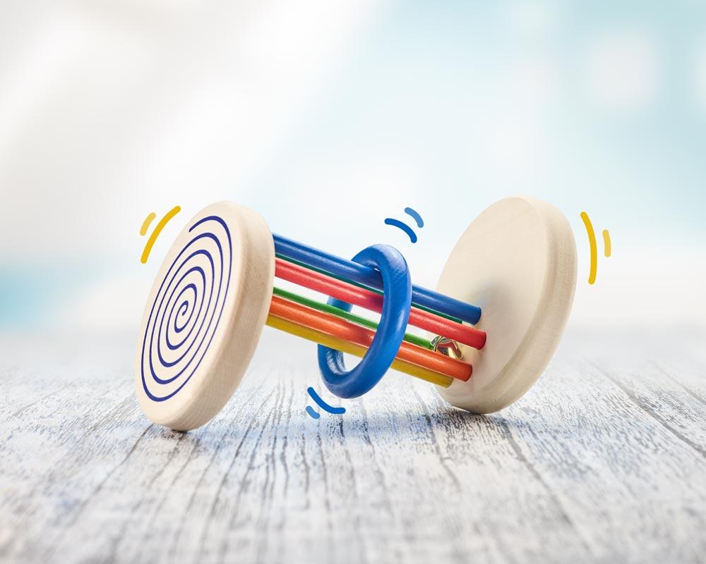 Jouet roulant bois effet visuel spirale